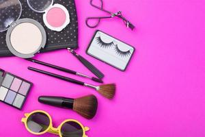 Cosmetic beauty products on pink background