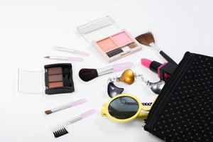 Top view of a make up bag with beauty products