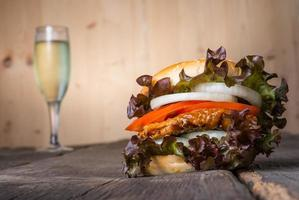 Home made chicken burger with champagne