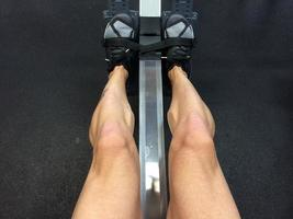 Close-up of a person sitting on a rowing machine