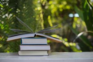 Stack of books on nature background