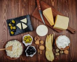 Top view of assorted cheeses and appetizers