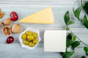 Top view of pieces of cheese with appetizeres