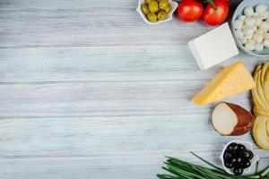 Top view of cheese and other appetizers with copy space