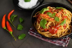 Italian spaghetti pasta with tomato sauce photo
