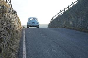 Volkswagen beetle car on the road photo