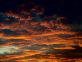 Orange clouds during golden hour photo