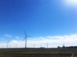 Windmills under a blue sky