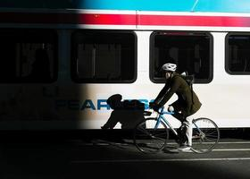 Person commuting on bicycle photo