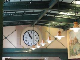 Hanging pendant lamp near clock