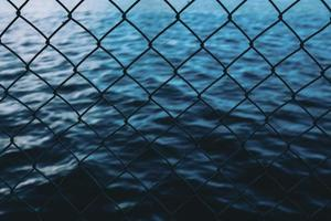 Water behind the chain link fence