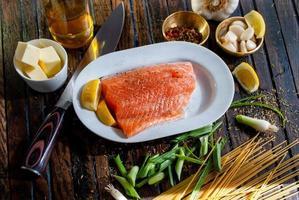 Flat lay photography of raw salmon fish photo