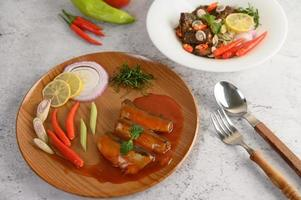 Spicy sardine dish with appetizers