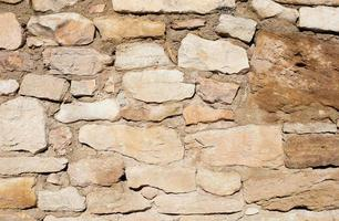muro de piedra beige foto