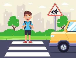 a schoolboy crossing the road