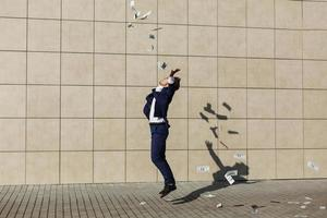 Young businessman throws around dollars