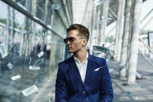Dollars flying around a man photo
