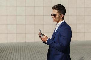Businessman walking with cash