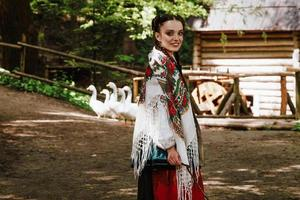 Smiling girl in a Ukrainian embroidered dress photo