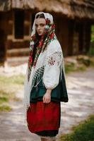 Elegant girl in embroidered Ukrainian dress photo