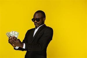 Rich man holds money photo