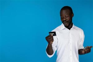 Man holding a credit card photo