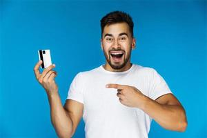 Man pointing to credit card