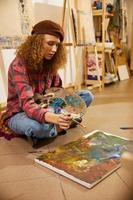 Artist painting on the floor