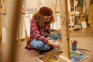 Artist painting a canvas photo