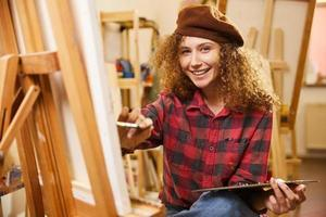 Smiling artist wearing a beret