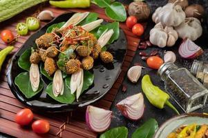 berberechos al curry y salteados foto