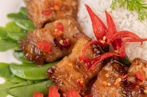 Pork belly on steamed rice photo
