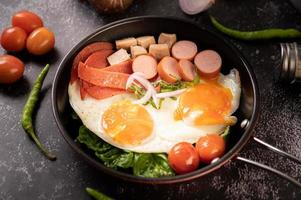 Egg breakfast with sausage and vegetables