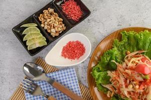 Thai papaya salad and ingredients photo