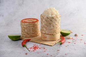 Thai sticky rice with chilies, lime and garlic photo