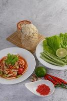 Thai papaya salad with ingredients photo