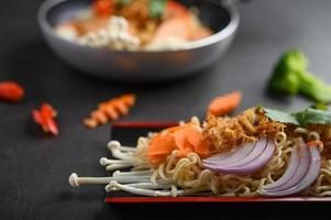Spicy noodles on gray background
