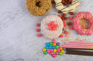 Decorative donuts on gray background photo