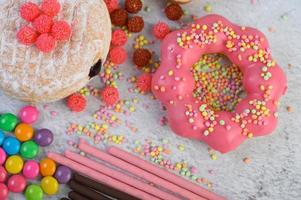 Strawberry donuts topped with a large amount of icing photo