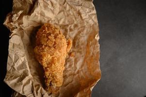 Crispy fried chicken on brown paper