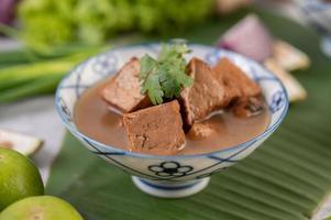 Stir-fried tofu on a banana leaf photo