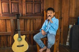 Boy singing while sitting