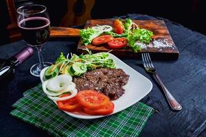 Plate with steak and a salad