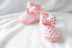 Newborn shoes on white bedding
