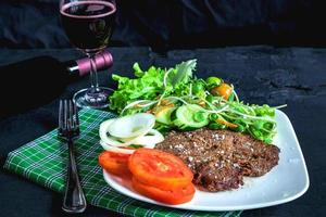 Steak and salad with wine
