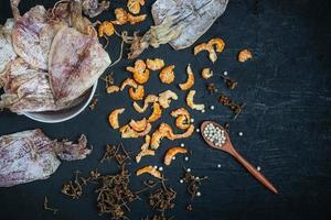Top view of dried seafood on a black background