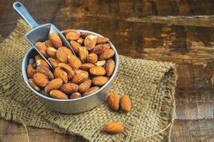 Metal bowl of almonds