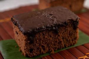 Chocolate cake on bamboo photo