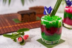 Dessert in a glass on a banana leaf