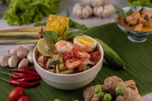 Tom yum noodles with shrimp and boiled eggs photo